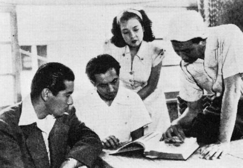 25_Toshiro Mifune Masayuki Mori Machiko Kyo and Akira Kurosawa on the set of The Idiot (1951).jpg