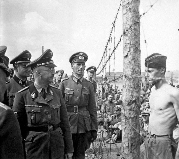 HimmlerinspectsaprisonerofwarcampontheEasternFront.Inthespringof1934Dachau.jpg