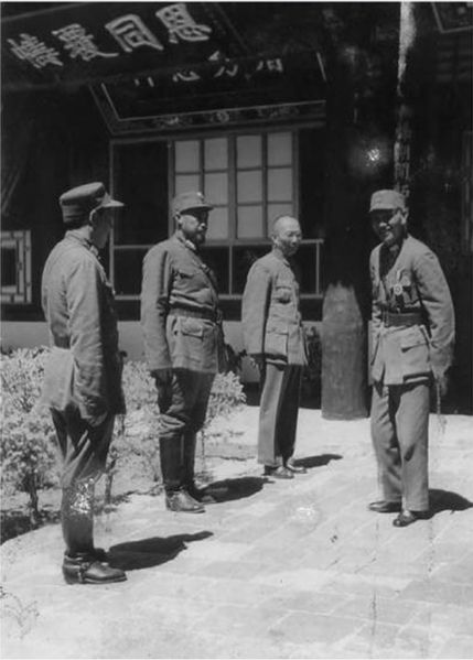 21 Chiang Kai-shek (right) meets with the Muslim Generals Ma Bufang (second from left) and Ma Buqing (first from left) in Xining at August 1942 during the height of war with Japan..jpg
