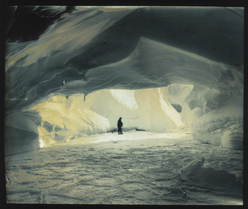 on-the-frozen-sea-in-a-cavern-eaten-out-by-the-waves-under-the-coastal-ice-cliffs-adelie-land-australasian-antarctic-expedition-1911-1914_6173956626_o.jpg