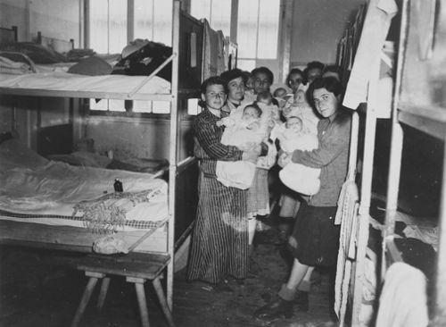 JewishmotherswiththeirbabiesinahospitalbarrackatDachauMay1945..jpg