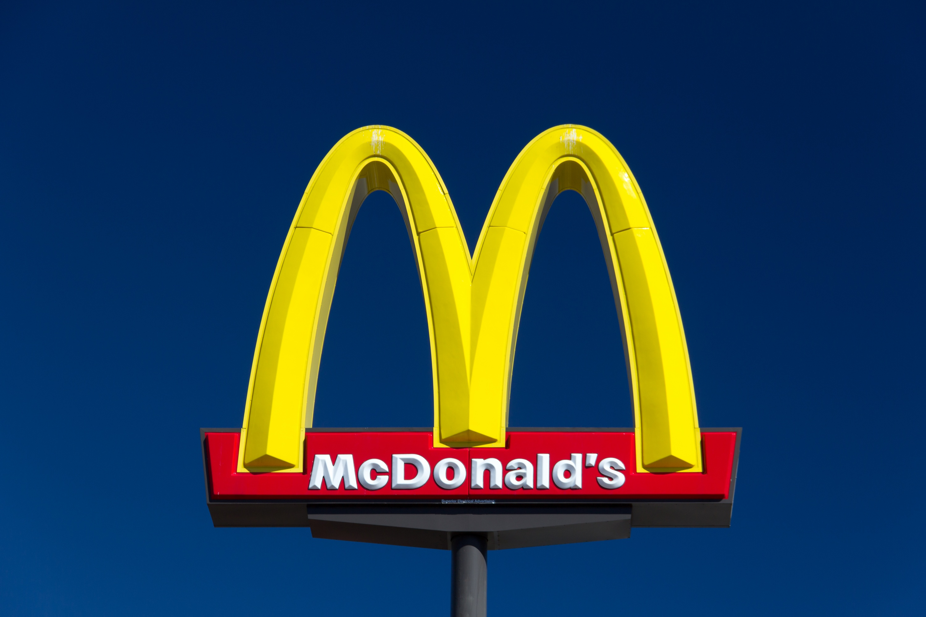 bigstock-Large-Mcdonald-s-Sign-69636400.jpg