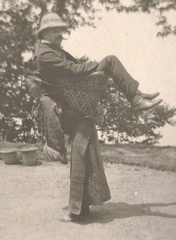 15 A Sikkimese woman carrying a European man on her back West Bengal India c. 1900..jpg