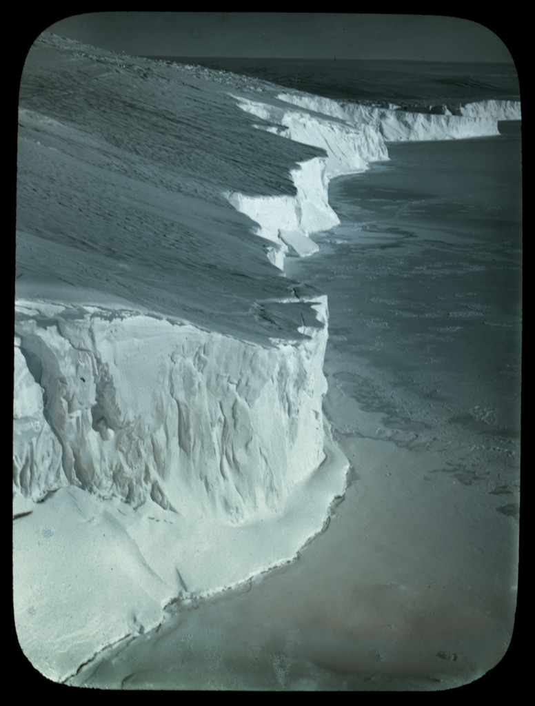 the-ice-cliff-coastline-east-of-winter-quarters-adelie-land-australasian-antarctic-expedition-1911-1914_6173950222_o.jpg