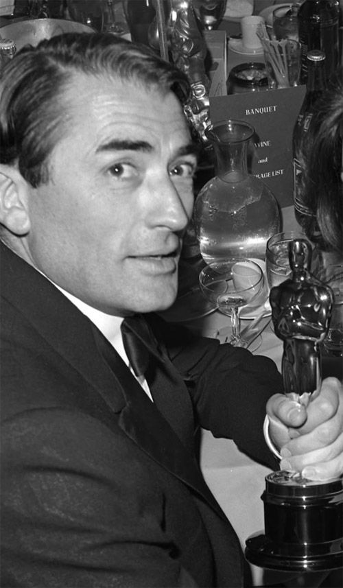 31 with his 1962 Oscar for Best Actor for his role as Atticus Finch in To Kill a Mockingbird.jpg