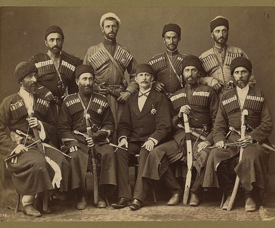A group of Cerkesler (Circassians) in traditional costume posing with another man (possibly an Ottoman official). Late-Ottoman era circa 1900..jpg