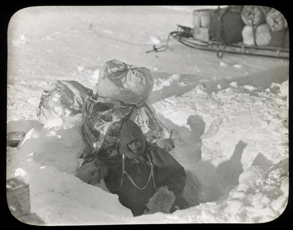 mertz-emerging-from-aladdins-cave-australasian-antarctic-expedition-1911-1914_6173421529_o.jpg