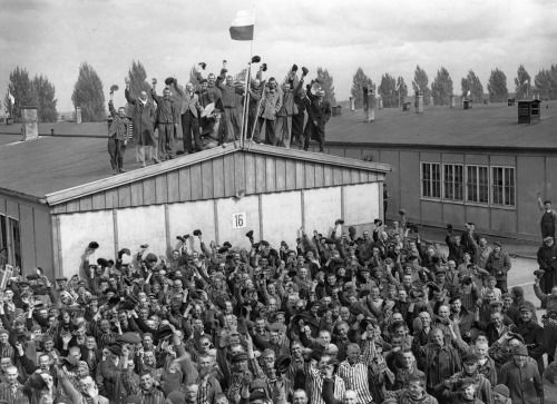 Dachauprisonerscelebratingtheirliberation4May1945.jpg