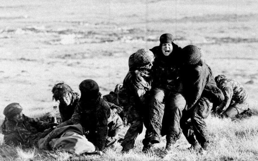4 British paratroopers carrying out emergency medical treatment on wounded comrades whilst under fire on Mount Longdon during the Falklands campaign 1982.jpg