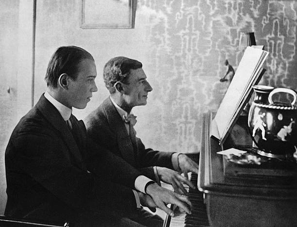 Choreographer Vaslav Nijinsky and composer Maurice Ravel at the piano playing a score from Daphnis and Chloe..jpg