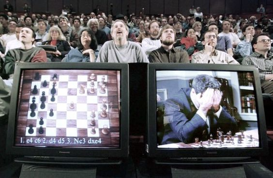 к Garry Kasparov on a television monitor at the start of the final match against IBMs Deep Blue computer in May 1997 in New York..jpg