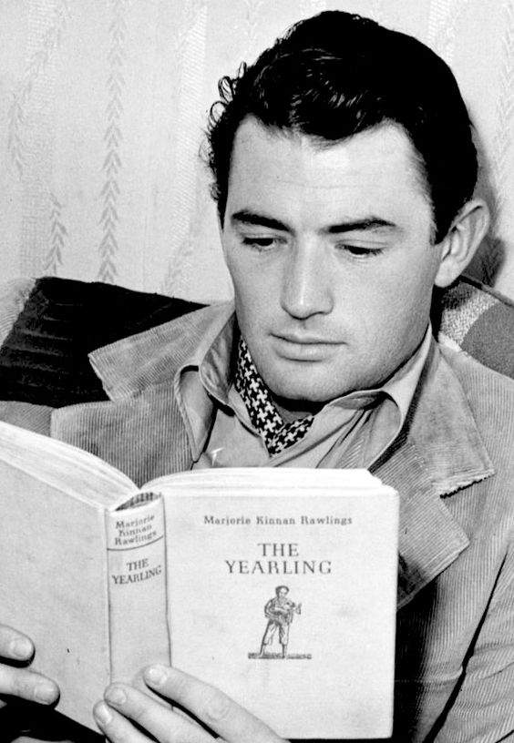 11 Gregory Peck reading the novel on the film set of The Yearling 1946.jpg