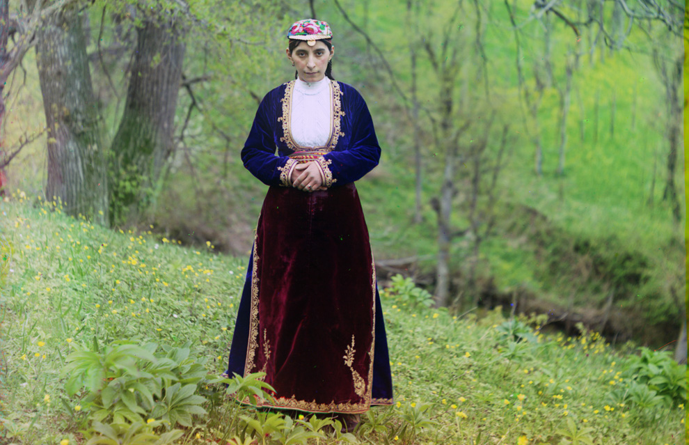 Armenian woman in national costume poses for Prokudin-Gorskii on a hillside near Artvin (in present day Turkey) circa 1910..jpg
