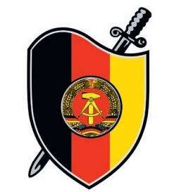 Эмблема Штази, «щита и меча». <br>